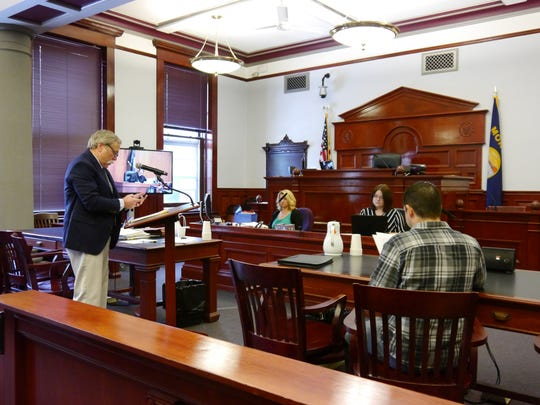 Attorney Mark Higgins, left, testifies in District Court in Great Falls that a lawsuit by Ryan Villines, right, should be dismissed because the claims made by Villines are now moot. Villines believes restrictions placed on the Cascade County Zoning Board of Adjustments seat denied citizens the opportunity to participate in local government.