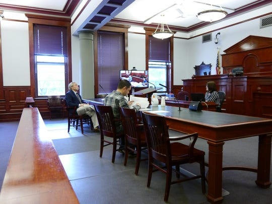 Attorney Mark Higgins, left, and Ryan Villines wait for a hearing to begin concerning Villines' lawsuit against Cascade County over conditions set on the Zoning Board of Adjustments appointment Friday, June 22, 2018.