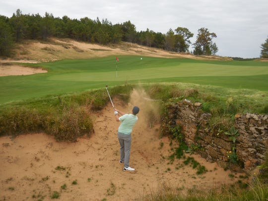 A golfer extricates his ball from a bunker on Mammoth