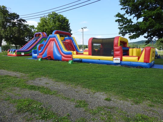 Bounce houses for kids were one of the attractions for the Independence Day festivities at the Coshocton County Fairgrounds, which featured a fireworks display, food, vendors and more.