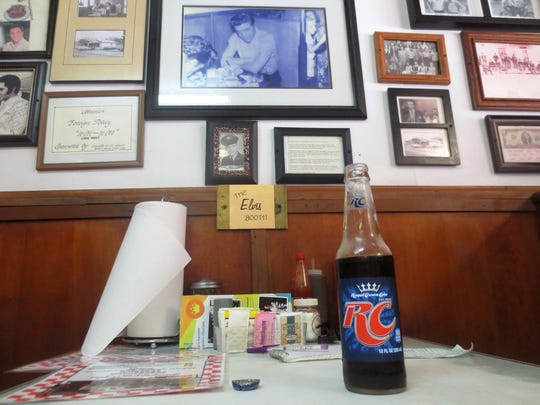 "The ""Elvis Booth"" at Johnnie's Drive-In, where Elvis Presley used to sip RC Colas after school."