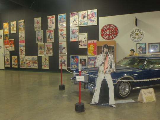 The Tupelo Automobile Museum houses a 1976 Lincoln that Elvis Presley bought and gave to a friend. Behind the car are 33 original movie posters from Presley's movies configured to spell his name.