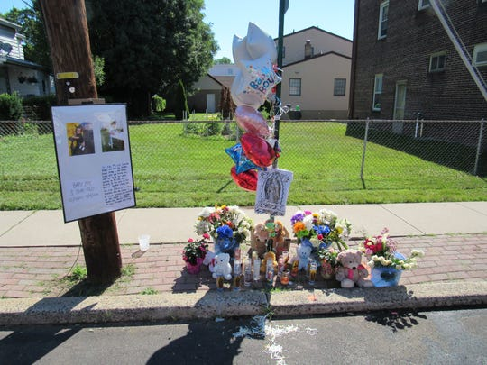 The shrine to the accident victims directly opposite St. Ann Church on Anderson Street in Raritan.