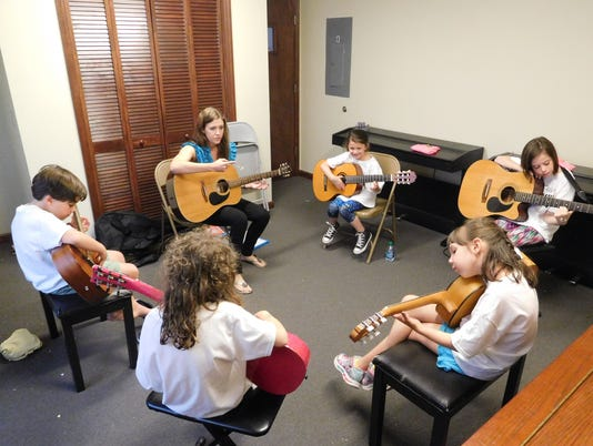 636668137696062866-Under-Lisa-Polombo-Barry-s-direction-campers-learn-the-intricacies-of-guitar.JPG