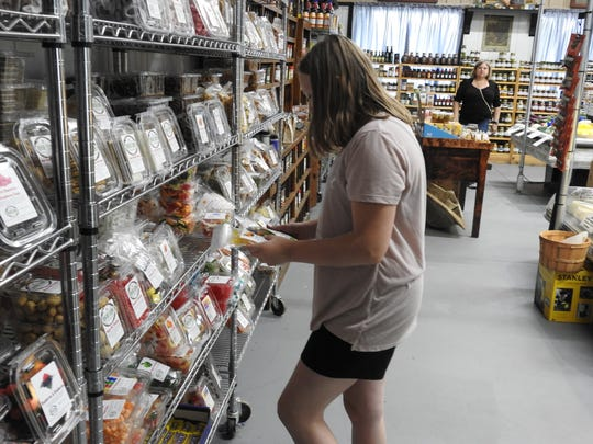 Sidney Beall, 11, of Newcomerstown looks at candy recently at the new McKenna's Farm Market in West Lafayette.
