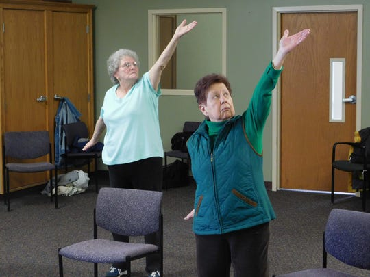 Kay Wilbur and Agatha Snoep (from left) participate regularly in McLaren Greater Lansing's weekly Tai Chi class for cancer survivors and co-survivors.