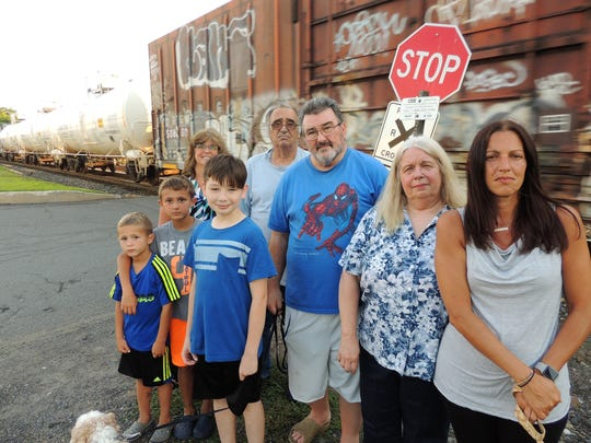 Some of the residents of Pineview Road in West Nyack stand at the private railroad crossing that is the only way into their neighborhood. The freight rail line CSX wants to shut the crossing, the site of four accidents since 2010. But the closure would leave the dozen Pineview families with no way in or out. Pictured from right: Jean Buzzell, Diane Fitzsimons, Bart Fitzsimons, Lou Bimbo, Andy Valdez, Susanne Madden, Vinny Buzzell, and Joe Buzzell.
