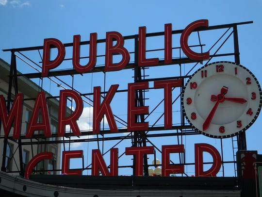 The Pike Place Market is a Seattle landmark where shoppers