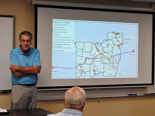 Ed Looman, Eastern Ohio Project Manager for the Appalachian Partnership for Economic Growth, with a map of the suggested corridor between Columbus and Pittsburgh that needs expanded to four lanes the whole way.