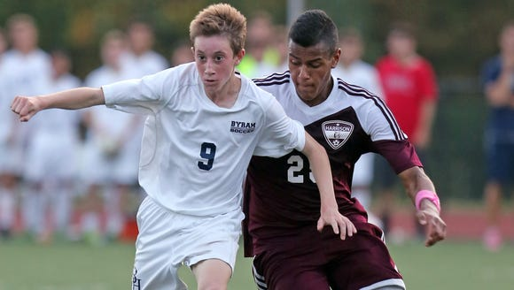 Ryan Noel (9) of Byram Hills and Harrison's Gabe Ferrierra