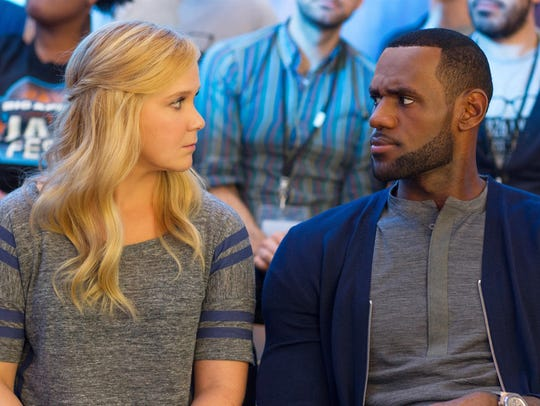 Amy Schumer and LeBron James appear in a scene from
