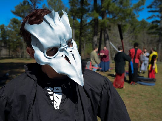 Terry Pierson has a custom-made leather mask he wears