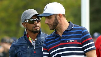 Team USA vice-captain Tiger Woods talks to  U.S. player Dustin Johnson during a Ryder Cup practice round Thursday at Hazeltine National Golf Club.