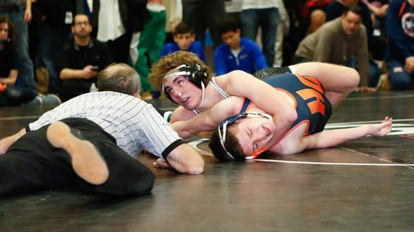 John Jay-Cross River's Louie Cree, top, defeats Horace Greeley's Joe Sasso in a 132-pound match at the Westchester County wrestling championships at Yonkers High School in Yonkers on Saturday, January 21, 2017.