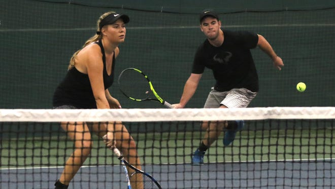 Darina Drozdova, from Russia, and Ontario grad Jacob Byrd form a nice partnership during mixed doubles in the 85th News Journal/Richland Bank Tennis Tournament at Lakewood Racquet Club.