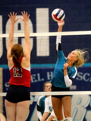Siegel's Leah Poarch (21) returns the ball over the net as she faces off agaisnt Cookeville's Sydney bean (12) during the game at Siegel, on Thursday, Sept. 1, 2016.