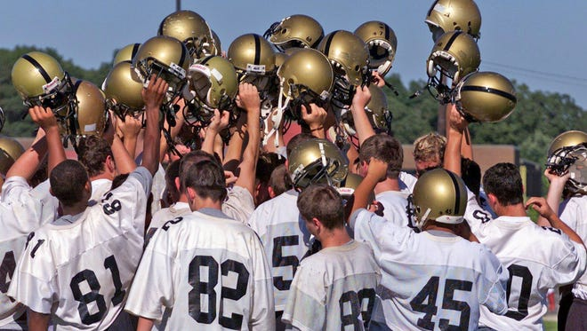 You might see of these players back on the field representing the Yellow Jackets on April 21. Pictured - 2002 Fairview High School football players gather around for a cheer before taking their water break during practice.
