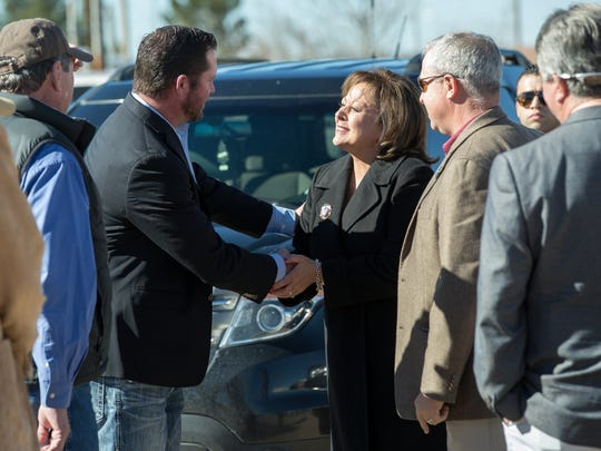 Gov. Susana Martinez shakes hands with Wholesome Family Farms owner Jay Hill on Monday, January 23, 2017 in Berino New Mexico.