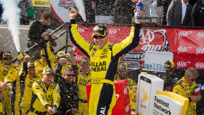 NASCAR Sprint Cup Series driver Matt Kenseth celebrates in victory lane after winning the AAA 400 Drive For Autism on May 15, 2016, at Dover International Speedway.
