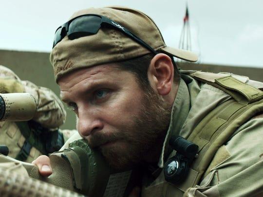 "Kyle Gallner, left, and Bradley Cooper in ""American"
