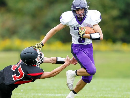 Dryden's Wes Stahlman escapes the grasp of Newark Valley's