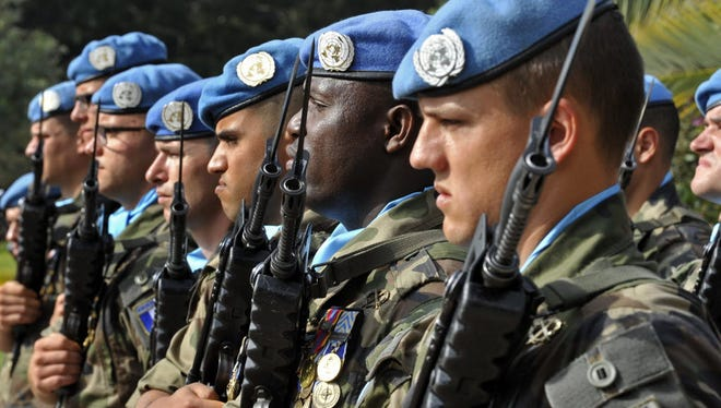 French United Nations peacekeepers stand at attention, May 2015.