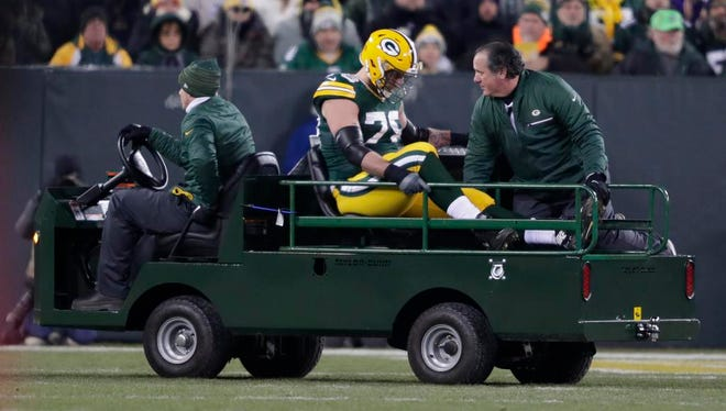 Green Bay Packers offensive tackle Jason Spriggs (78) leaves the field after getting injured against the Vikings Saturday, December 23, 2017, at Lambeau Field in Green Bay, Wis.
