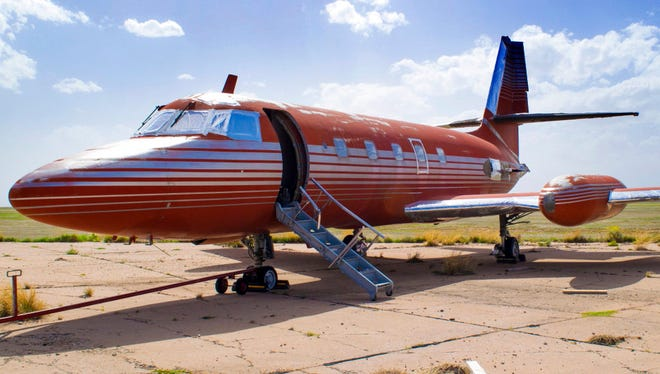 This undated file photo provided by GWS Auctions, Inc. shows a private jet once owned by Elvis Presley, on a runway in New Mexico. The private jet that sat on the runway in New Mexico for nearly four decades is back on the auction block. The online auction site IronPlanet announced that the plane with red velvet seats had returned to the market after its current owner bought it last year for $430,000.