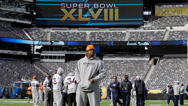 Denver Broncos players look around MetLife Stadium before the team's walk-through on Saturday.