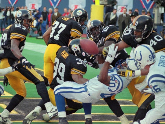 Indianapolis Colts Aaron Bailey(80) can't handle a touchdown pass from quarterback Jim Harbaugh in the last play of the game aganist the Pittsburgh Steelers in Pittsburgh Sunday Jan. 14, 1996 as the Steelers Darren Perry(39), Randy Fuller(29), Myron Bell(40)and Carnell Lake(37) look on with the Colts Brian Stablien(86). The Steelers won 20-16.(AP Photo/Keith Srakocic)