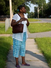 Betty Jennings waits outside her Milton area home for