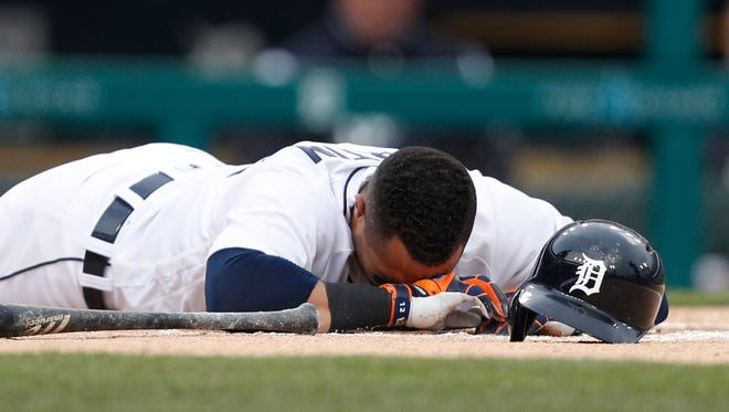 Detroit Tigers center fielder Leonys Martin (12) goes down after an injury during the first inning against the New York Yankees at Comerica Park on April 13, 2018.