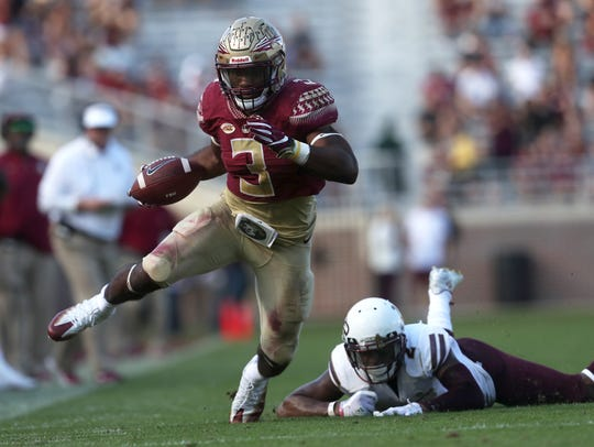 FSU's Cam Akers runs past Louisiana Monroe's Hunter