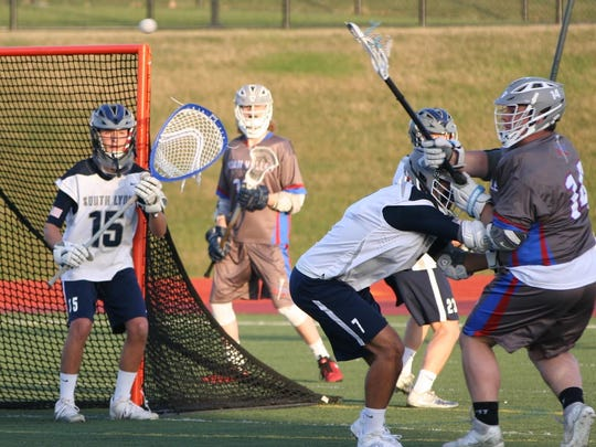 South Lyon Unified goalie Conner Pergament guards the net in last week's five-goal victory over Huron Valley.