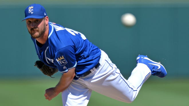 Kansas City Royals pitcher Travis Wood pitches during the third inning against the Cleveland Indians at Surprise Stadium on March 18.
