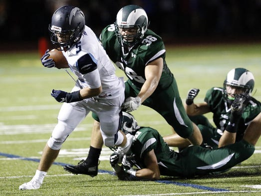 Manheim Township's Kade Kubicki breaks two tackles