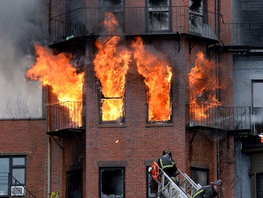 Boston firefighters work a brownstone fire.