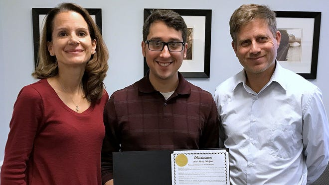 Corning chiropractors Denise Nicastro, Samuel Ascioti and David Kartzman show off a Steuben County proclamation regarding National Chiropractic Health Month.