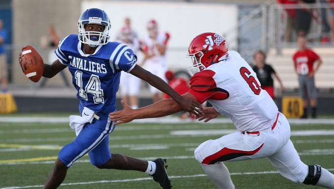 Chillicothe's Branden Maughmer eludes a Jackson defender in Week 2 at Herrnstein Field. The Cavaliers travel to East Clinton this Friday to open SCOL play.