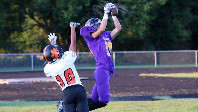 Unioto's Casey White catches a pass during last week's contest against Waverly at Unioto High School. White's Shermans have started the year at 2-1.