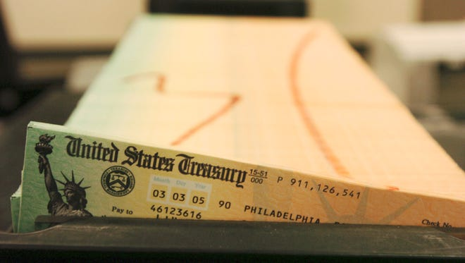 Trays of printed Social Security checks wait to be mailed from the Treasury's Financial Management services facility in Philadelphia.