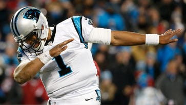 Carolina Panthers quarterback Cam Newton (1) dabs during the fourth quarter against the Arizona Cardinals in the NFC Championship football game at Bank of America Stadium. Jan 24, 2016; Charlotte, N.C.