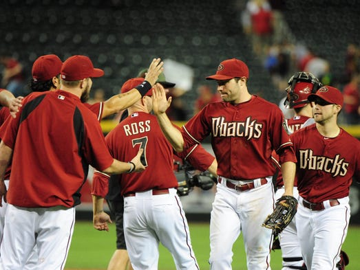 Members of the Arizona Diamondbacks celebrate after beating the San Diego Padres 12-6 at Chase Field on May 28, 2014.