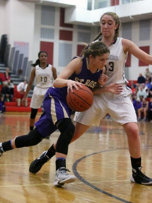 NJSIAA Girls Basketball Non-Public School championship game with Rutgers Prep taking on St. Rose High School at Jackson Liberty High School on Tuesday March 8, 2016.St Rose's # 20-Ellyn Stoll  (left) tries to get around Rutgers Prep's # 32 (right) Andrea Gamboa.