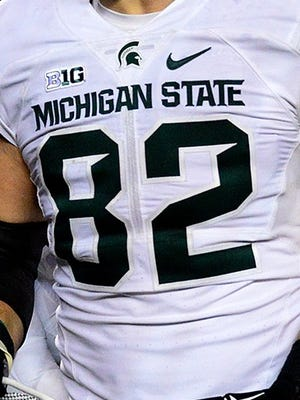 Michigan State tight end Josiah Price screams as he celebrates with teammates after a thrilling, last-second 27-23 victory over Michigan Saturday, October 17, 2015, in Ann Arbor.