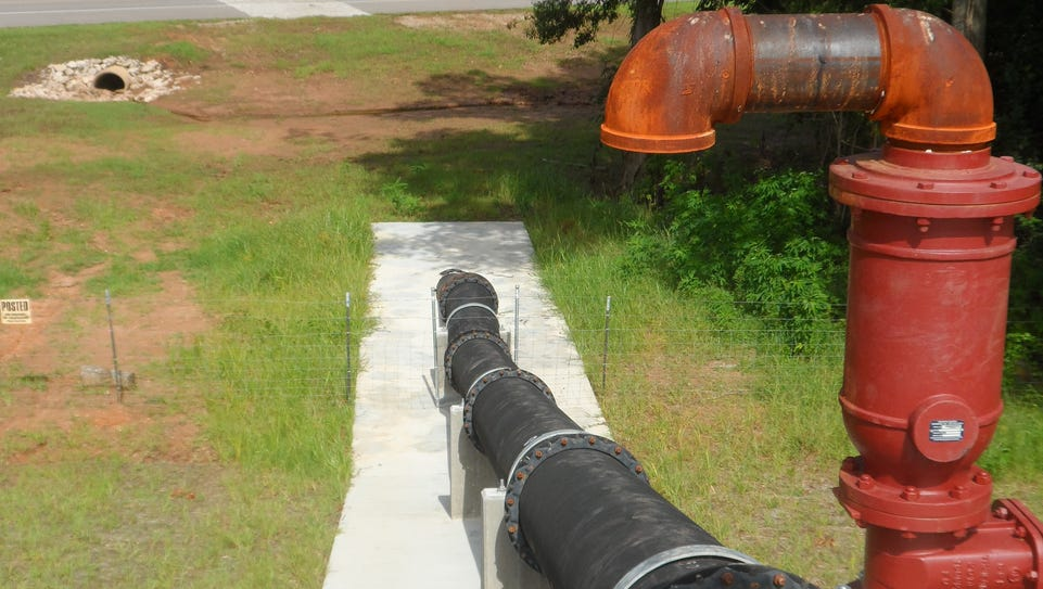 A sewer pipe from the Pineville sewer plant runs above
