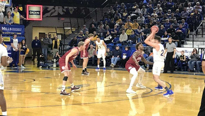 Mike Daum makes a move at the top of the key in Saturday's win over Denver at Frost Arena