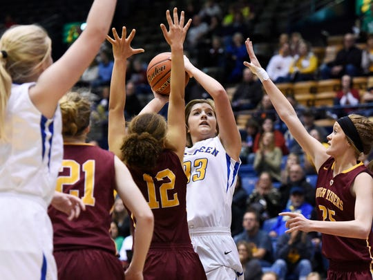 Aberdeen Central's Paiton Burckhard (33) takes a shot past Roosevelt's Kira Ward (12) and Peyton Stolle (25) in a state girls class AA basketball quarterfinal Thursday at the Sioux Falls Arena, March 17, 2016. Aberdeen Central beat Roosevelt 64-55.