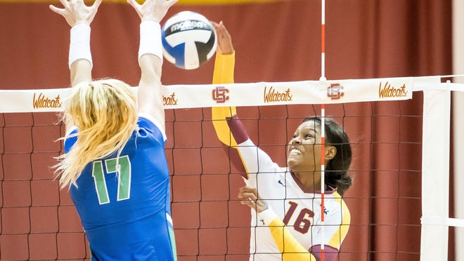 B-CU volleyball standout Miranda White, right, earned a Nike scholarship.