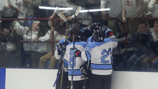 Suffern celebrates Kyle Foresta (21) from scoring the first goal of the game against Mahopac during a ice hockey game at Sport-O-Rama in Monsey Feb. 24, 2017.